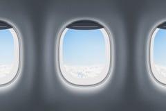 Tre flygplan- eller strålfönster Arkivbilder