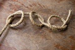 Tre fnuren på gammalt träbräde Arkivbild