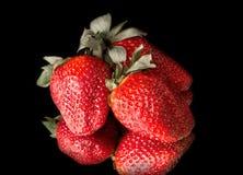 Tre fragole fresche Immagini Stock