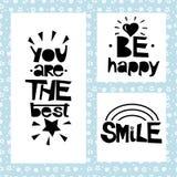 Tre frasi su fondo nero delle stelle e delle spirali Sia felice Siete il migliore sorriso Fotografia Stock