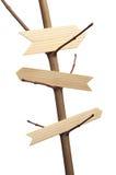 Tre frecce di legno su un ramo di albero Fotografia Stock