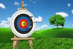 Tre frecce su un obiettivo di tiro con l'arco Immagine Stock