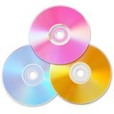 Tre färgade CD Royaltyfria Foton