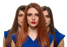 Tre fronti delle donne sorelle dei tripletti Fotografie Stock