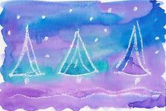 Tre frostiga julgranar Arkivfoto