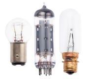 Tre gamla elektriska lampor på vit Royaltyfri Bild