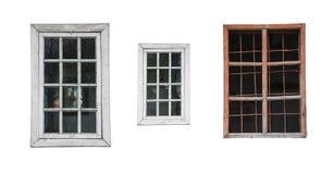 Tre gamla fönster på vit bakgrund som isoleras Arkivfoto