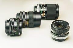 Tre gamla fotografiska linser royaltyfri bild