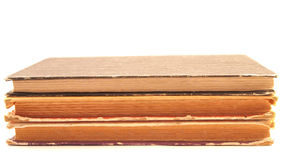 Tre gamla sjaskiga böcker Arkivbild