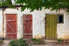 Tre gamla trämålade dörrar Royaltyfri Foto