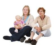 Tre generazioni 10 su bianco Immagini Stock