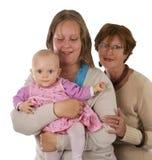 Tre generazioni 7 su bianco immagine stock