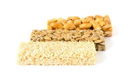 Tre generi di kozinak delizioso su un fondo bianco Fotografia Stock