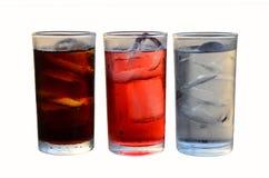 Tre generi di vetri del rinfresco su fondo bianco immagine stock
