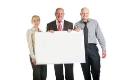 Tre genti di affari che tengono un'insegna Fotografia Stock Libera da Diritti