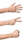 Tre gesti di mano. Gioco di carta di forbici della roccia Fotografia Stock