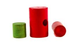 Tre giocattoli di legno variopinti su bianco immagine stock