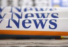 Tre giornali rotolati Fotografia Stock