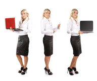 Tre giovani donne di affari con i computer portatili Immagini Stock