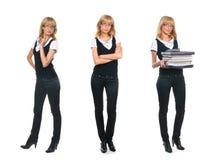 Tre giovani donne di affari in vestiti convenzionali Fotografia Stock Libera da Diritti