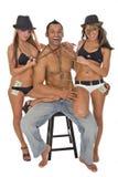 Tre giovani modelli che hanno divertimento Immagini Stock