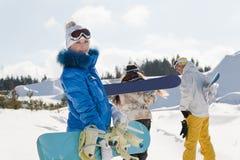 Tre giovani snowboarders Fotografia Stock Libera da Diritti