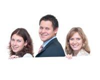 Tre giovani una squadra Immagini Stock