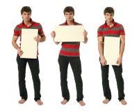 Tre giovani uomini con la copia spaziano i segni in bianco Immagini Stock