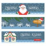 Tre glade jul isolerade baner på en vit bakgrund med gåvaaskar, Santa Klaus, det Santas huset och snöflingan Royaltyfri Fotografi