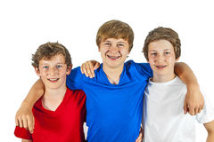 Tre glade vänner tycker om liv Arkivfoton