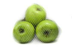 Tre gröna äpplen Arkivfoton