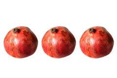 Tre granatäpplen på vit bakgrund Arkivfoton