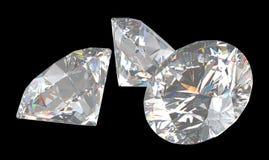 Tre grandi diamanti brillanti del taglio Fotografia Stock