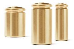 Tre guld- färgbatterier Royaltyfri Bild