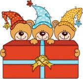 Tre gulliga nallebjörnar med den stora röda gåvaasken stock illustrationer