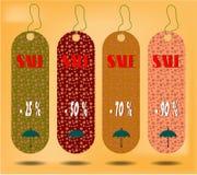 Tre hängande etiketter med text Sale, etiketter som göras från Royaltyfri Foto