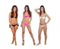 Tre härliga modeller i bikini royaltyfri bild