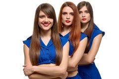 Tre identiska kvinnor Arkivbild