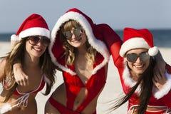 Tre il Babbo Natale felice che ha divertimento Immagini Stock Libere da Diritti