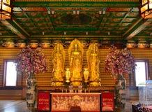 Tre immagini dorate di Buddha immagine stock