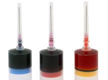 Tre injektionssprutor med målar Royaltyfri Fotografi