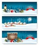 Tre insegne di Natale di festa con un villaggio di inverno illustrazione di stock