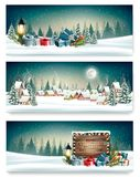 Tre insegne di Natale di festa con un villaggio di inverno illustrazione vettoriale
