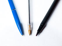 Tre isolerade pennor Arkivbilder