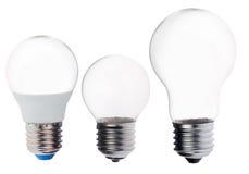 Tre isolerade tomma lampor på vit Arkivbild