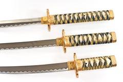 Tre japanska samurajkatanasvärd Arkivbilder