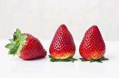 Tre jordgubbar Royaltyfri Fotografi
