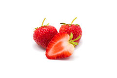 Tre jordgubbar som isoleras på vitbakgrund royaltyfri foto