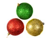 Tre julbollar som isoleras på white Royaltyfria Bilder