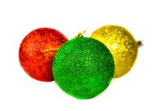 Tre julbollar som isoleras på white Royaltyfria Foton